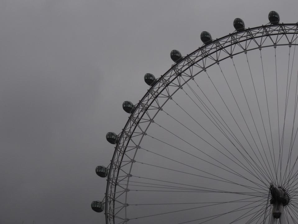 The London Eye against lowering cloud.
