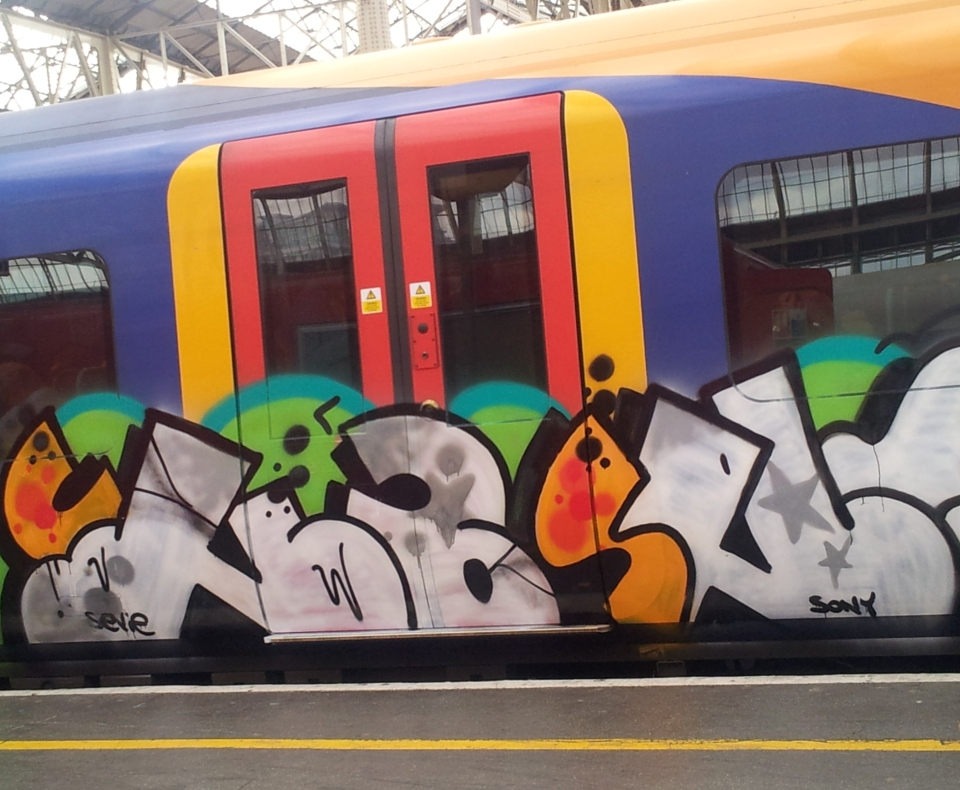 South West Trains must hate graffiti, but it does liven up this train at Waterloo