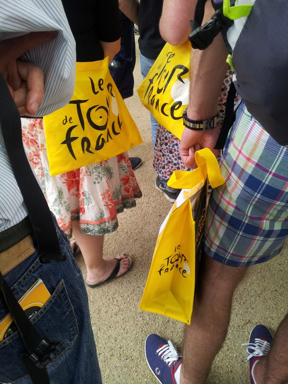 Bags in the (very, very long) queue for official souvenirs