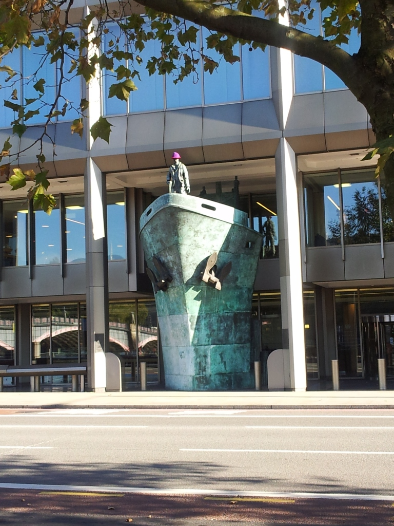 The seafarer outside the International Maritime organisation's HQ wears a woolly hat for Woolly Hat Day (organised by the Missions to Seafarers', which gives out woolly hats to sailors).