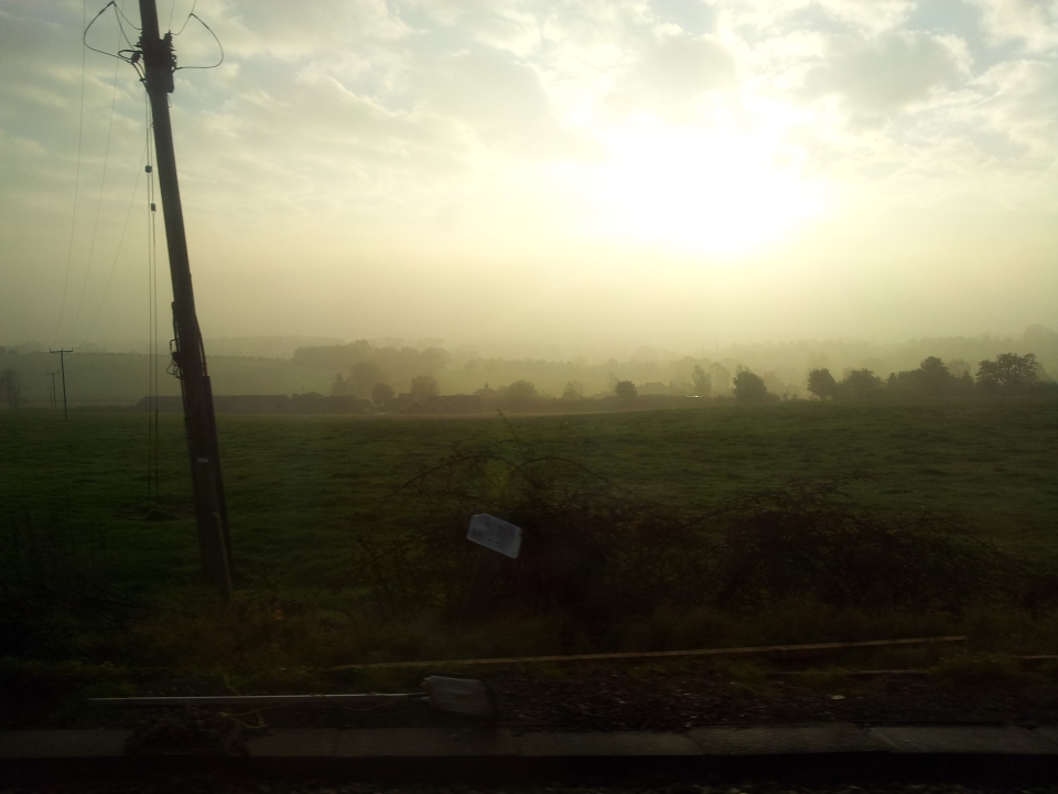 Another shot taken from a (slow) moving train near Micheldever, this time looking towards the South Downs. I was after the sunrise; but I like the line of telegraph poles adding an industrial aspect to the landscape.